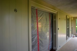 "The doorway leading into my foyer is covered to protect it from any dust and debris - this is where the door used to be. You will see the difference it makes to move a door just several feet forward in the March issue of ""Living""."