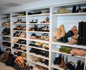 As you can see, I have a lot of shoes. I always situate my shoes by type and style. When I find some I love, I often get two or three pairs in different colors. These convenient shoe shelves fill an entire wall in this room, but needed to be tidied up.