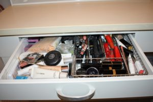 Lipsticks, mascaras, powders, etc. are just thrown in wherever there is room - it has become quite difficult to find things.