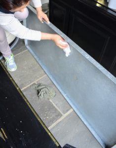 This large galvanized tray holds the bedding. It is also removed and carefully wiped down.