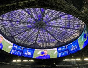 The roof design includes eight triangular translucent panels, that when opened create the illusion of a bird's wings extended. It was closed for most of the game. The giant halo video board surrounds the opening of the roof.