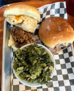 These are the cracklin' sliders - this one with classic pulled pork, tossed in the signature BBQ sauce, topped with fried pork skins, and served with one side - collard greens.