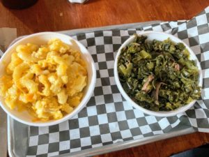 These are two of their signature sides - macaroni and cheese and collard greens.
