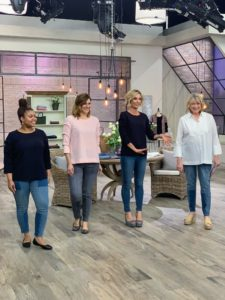 Here, the QVC models are showing off my new Knit Crepe Gathered 3/4 Sleeve Top in navy and shell pink. The simple gathering along the sleeve seam makes this fun blouse stand out. I am wearing my Stretch Poplin Bracelet-Sleeve Blouse with Bib Detail. This blouse is so versatile - wear it alone or under your favorite sweater. It comes in several colors including white, navy, seed green, Sharkey gray and shell pink. We're also wearing my 5-Pocket Patchwork Ankle Jeans.