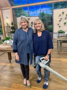 Here I am with QVC host, Pat James-Dementri. She's holding my 6-Amp Lightweight Electric Blower - great for porches, patios, walkways, decks, and garages. It is so lightweight and easy to use.