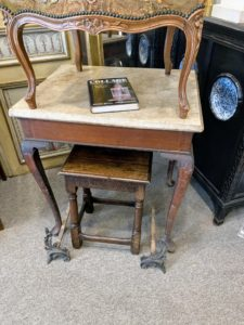 I loved this tea table with its marble top. It needs some refinishing, but it was so pretty - I almost bought it.