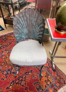 This chair appealed to me as well, with its decorative shell-like back. It was very well made.