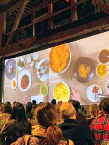 A large screen showed the actual preparation of the food in the kitchen.