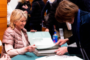 I enjoy these book signings because I get to talk with each of the guests in line. This guest bought two books to give as gifts. (Photo by Marlon Co for NYBG)