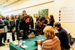 """Following the lecture, Kevin and I moved to the adjacent gallery for a book signing. Guests were able to purchase copies of """"Martha's Flowers"""" and then get them personally signed. (Photo by Marlon Co for NYBG)"""
