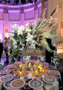 This piece combining white orchids and green foliage is from Mitchell Hill. http://mitchellhillinc.com/