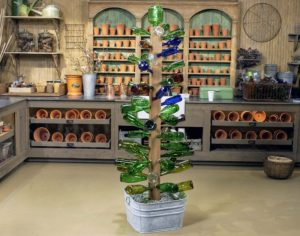 No, this Bottle Tree was not grown in my garden, but, it is a whimsical way to reuse and display colorful glass bottles.