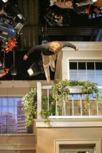 Use extreme caution whenever you're on an elevated surface. I took a nasty fall, right after watering the window boxes on set.