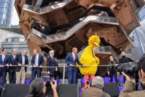 Big Bird asked the development team to join him and hold the ceremonial rope.