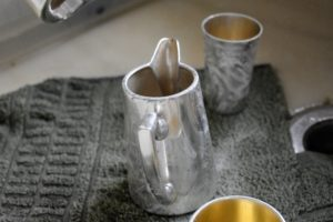 After washing the piece with dish soap and warm water to remove any dust, apply a small amount of silver cream.