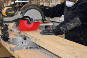 This is a compound miter saw designed to make very clean cuts. The crew worked in the large garage of the Equipment Barn next door, where there was more room for the lumber and tools.