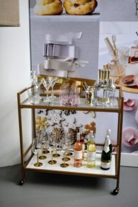 This glass cart fits perfectly in a corner or against a wall to hold a variety of bar-keeping essentials from Macy's.