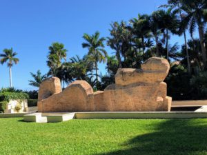 """Visitors to Ann Norton Sculpture Gardens see large scale works made of brick and granite positioned throughout a lush, native landscape. Ann Norton was an American sculptor whose works were exhibited in New York and in Florida as well as in Europe. The gardens include nine of her monumental sculptures. This one is """"Untitled Horizontal Sculpture"""", 1979."""