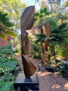 """Shows of other artists are sometimes presented at the Gardens. This sculpture was made by Gino Miles and is called """"Travels to Hania"""". It is a bronze piece set on a granite base. His pieces will be exhibited through May 12th."""