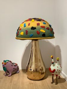 In another room - bronze toadstools embellished with colorful glass beads. These whimsical pieces were made in collaboration on beaded works with a group of South African women who dubbed themselves the Haas Sisters.