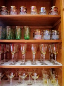 On the lower shelves of this cabinet - Venetian glass. These glasses have such a beautiful tint of yellow.