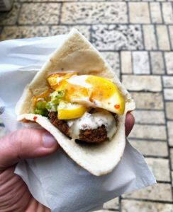 Sarah and Thomas took a day trip to Western Galilee - to the city of Akko. Thomas had a falafel with lightly pickled lemons, tahini sauce and amba, a pickled mango condiment. He loved it.