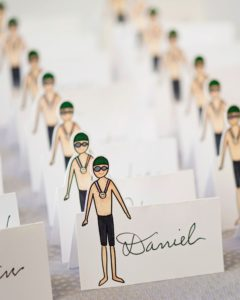 Place cards featured a swimmer in honor of Andy, who started swimming at a young age and then continued competing in college as a varsity swimmer and water polo player. Today, he swims with Asphalt Green's adult swim team.