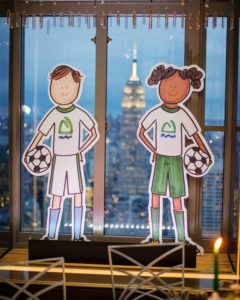 Soccer player figures decorated this window sill. During Andy's tenure, he headed several of Asphalt Green's big achievements, including opening a second location downtown in Battery Park City, organizing more activities throughout the city's public school system, and serving 50-thousand New Yorkers each year who participate in free community sports and fitness programs.