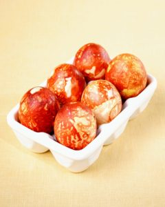 Natural materials yield beautiful results. Create this mottled look by wrapping eggs in onion skins, secure with cheesecloth, then boil in water and vinegar for 20-minutes.