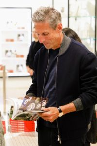 Here's businessman Richard Perry looking at some of the recipes in the book. (Photo by Neil Rasmus, BFA)