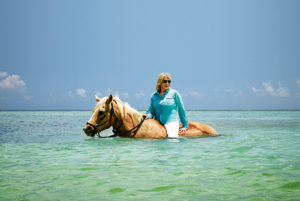 As you know, I love to horseback ride. Here I am riding in the Cayman Islands, one of our new MSC Cruises destinations, where you can take this refreshing ride through the azure colored Caribbean ocean and then enjoy a delicious and organic lunch.