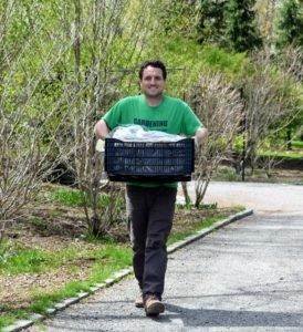 Here is Ryan transporting the first crate of lilies to be planted in the area.