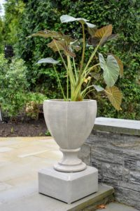 This is my two-piece 23-inch Faceted Urn with False Bottom Insert and Riser. It is made to look like stone, but it is made of a fiber resin that is much lighter and easier to carry.