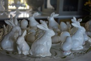 In my servery, the center counter is filled with more bunnies and eggs - these are all white porcelain - they look lovely in this antique glass stand.
