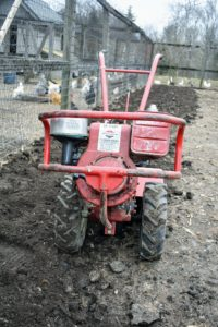 This is our Troy-Bilt Pony Rear-Tine Tiller. Rototilling is one method of turning up the soil before planting the garden. We rototill the vegetable garden every year - regular tilling over time can improve soil structure.