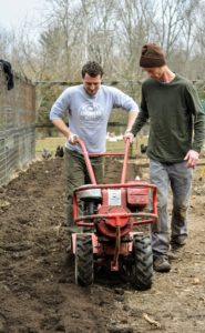 Here is Ryan showing Gavin how it's done - the machine needs a lot of control to maneuver it through the soil beds.