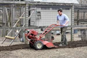 Ryan starts tilling the beds on one side of the garden and goes counter-clockwise around and around the entire space.