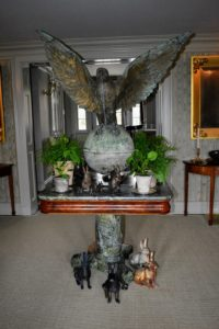 Under my giant falcon in the foyer - a lovely collection of rabbits surround the potted Chinese money plants, Pilea peperomioides, and ferns.