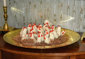 And here are more nesting chicks on a demilune in my front hall.