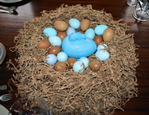 As centerpieces, we surrounded charming blue glass rabbit candy dishes with lots of natural colored small eggs in nests of natural brown. Remember, you can save eggs from years past and reuse them in different ways.