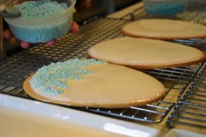 If you're careful, they come out so perfectly. I sprinkle blue colored dragees on top for a fun and festive touch on my giant egg cookies. The important thing is to avoid bubbles. If you get one or two, just poke them with the end of a skewer.