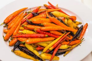 Brightly steamed carrots in a variety of colors were served as a side dish.