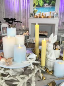 On this table, we created displays with pillar candles of varied heights and tapered candles in coordinating colors. And because the flames are LED - everything is completely safe.