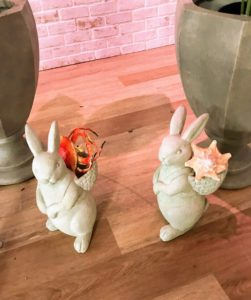 In another corner - my indoor and outdoor bunnies. These sweet garden bunnies come with empty backpacks to fill with springtime flowers or other decor. They have an antiqued white finish resin construction and measure approximately 14-inches tall.