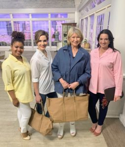 And here I am with the QVC models who are wearing my new Stretch Poplin 3/4-Sleeve Top in butter, white and peony. I am wearing the French blue to match the French blue Anorak. We're also holding my Canvas Totes with Leather Trim in the fawn color. I have so many products in my collections and we're adding to them all the time. Be sure to follow my social platforms to see when I am on QVC next.