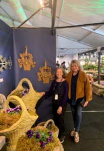 Here I am with Judith Milne - I stop at the Milne booth every year. It always has many large and beautiful outdoor planting containers.