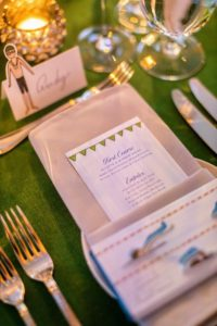 Dinner included a lovely menu - ricotta and almond salad, roasted black cod with miso glaze or roasted beef tenderloin, and for dessert - a choice of New York cheesecake, flourless chocolate cake or a piece of Meyer lemon tart. Candy bars decorated with Darcy's art work and featured swimming pool and soccer field wrappers made nice favors for guests. (Photo by Scott Rudd @scottruddevents)