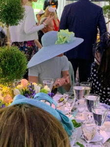 Muffie Potter Aston wore this very wide-brimmed light blue hat embellished with light green flowers.