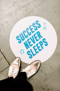 Here is a decal on the floor reminding guests that attaining success needs lots of work. (Photo by Bekah Linder)