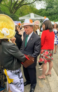 "The gentlemen guests wore hats too. Former Mayor Michael Bloomberg donned this fedora with an orange tag in tribute to honoree Patricia Harris, who brought Christo and Jeanne Claude's ""The Gates"" to the park in 2005. Several others behind him had the same idea."